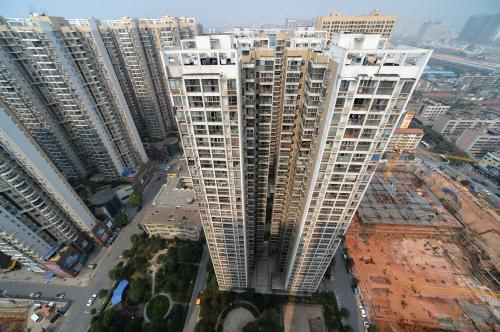 住建部:热点城市楼市降温 房价逐步趋于稳定